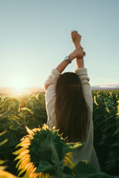 self care day, woman in a sunflower field