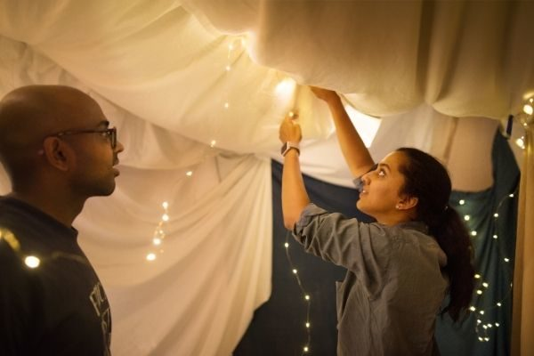 build a blanket fort for cheap and easy at home Valentine's Day ideas for couples
