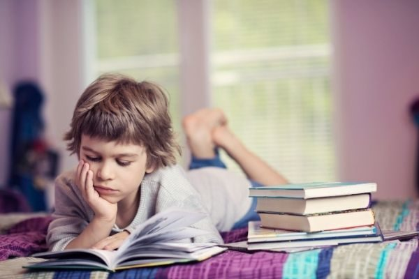boy reading: use the bookmark coloring pages