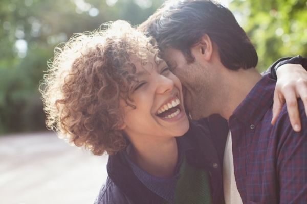 flirty funny couples questions, woman laughing